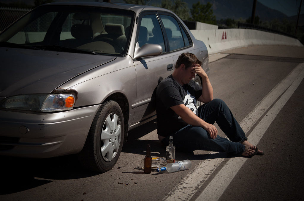 How do DUI charges affect a license in Alberta?